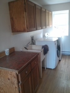 The renovated laundry room with new counters and storage