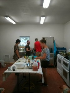 Maly, Mariah, Sam, and Norma Jean prepare ingredients for dressings