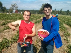 Jordan and Chris with their strawberries